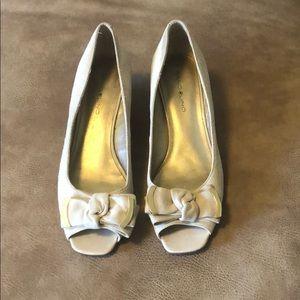 Nude faux suede peep toe wedges